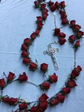 Rosary Holding 53 Roses