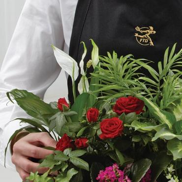 The Florist Designed Blooming and Green Plants in a Basket